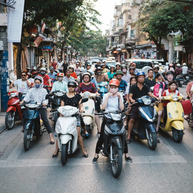 Scooter in Hanoi waiting for the traffic light [David Tan]